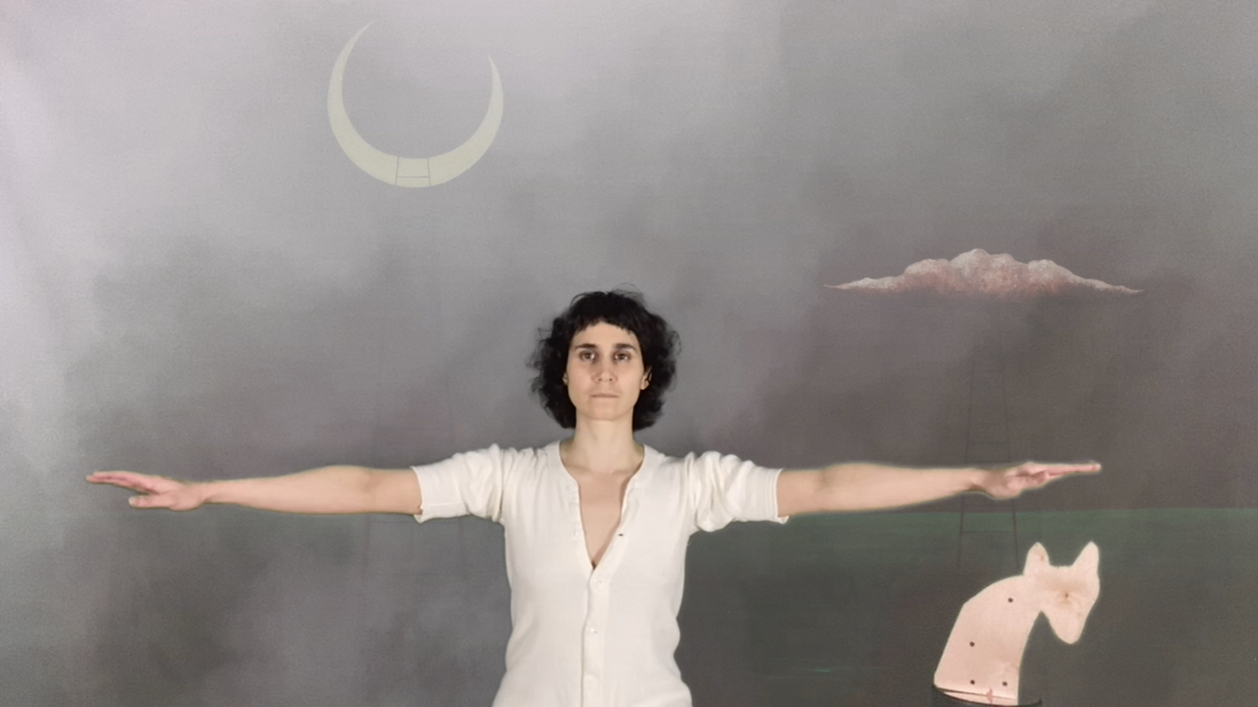 A white femme with curly dark brown hair faces straight at us with arms outstreched from shoulder. Some mist partially fills the left side. She is front of a painted background with a crescnet moon and a pink cloud in the sky. A ladder connects the pink cloud to the green field. Under her left hand (to our right) is the shape of a hyena head, pink.